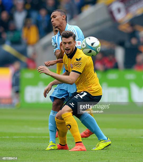 Quirin Moll of Dresden is challenged by Raphael Jamil Dem of Chemnitz during the Third League match between SG Dynamo Dresden and Chemnitzer FC at...