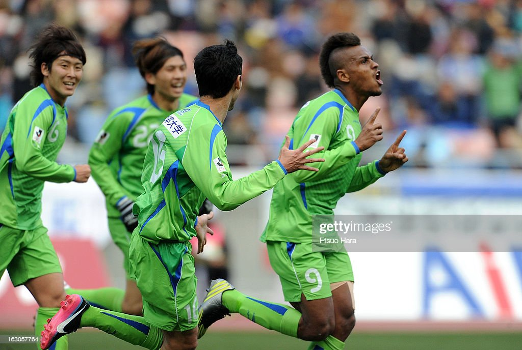 Quirino (1R) of Shonan Bellmare celebrates scoring the first goal during the J.League match between Yokohama F.Marinos and Shonan Bellmare at Nissan Stadium on March 2, 2013 in Yokohama, Kanagawa, Japan.
