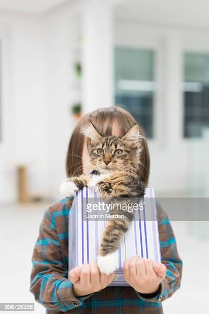 quirky boy holding cat - happy birthday cat stock pictures, royalty-free photos & images