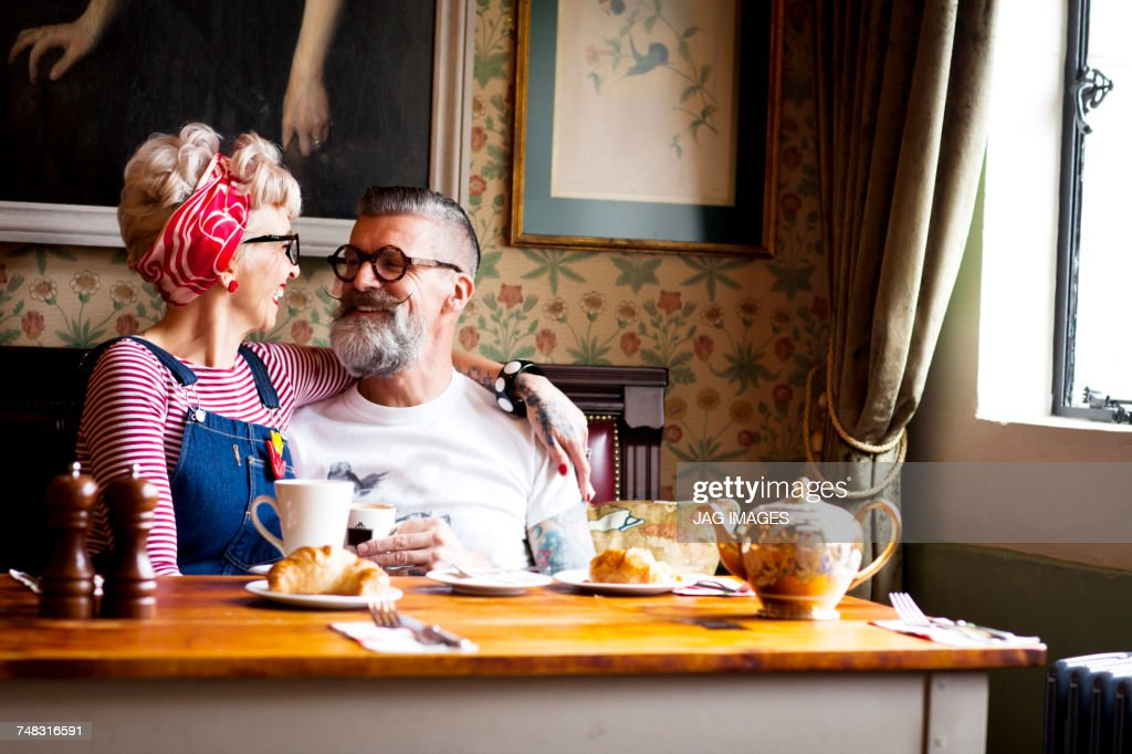 Quirky couple relaxing in bar and restaurant, Bournemouth, England : Stock Photo
