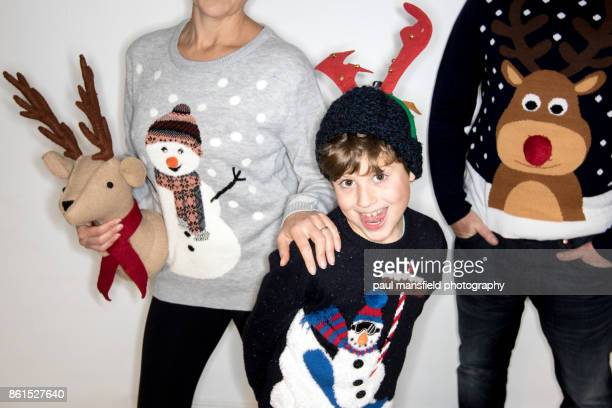 Quirky portrait of family wearing Christmas jumpers