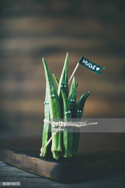 Quirky still life of okra vegetables in group hug