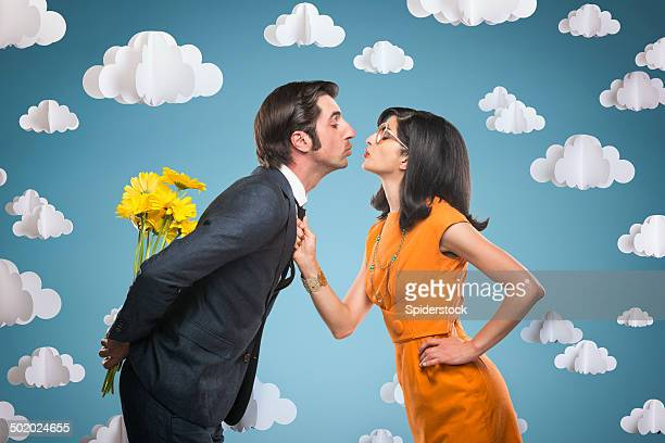 quirky stylish couple kissing - freaky couples stock photos and pictures