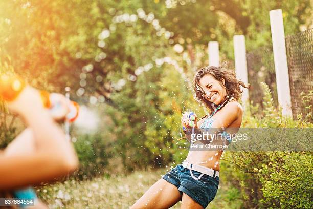 quirt guns fight - girl fight stock photos and pictures