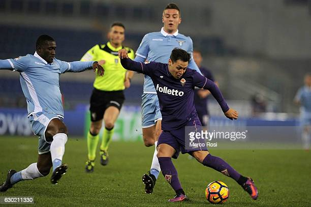 Quissanga Bastos of SS Lazio compete for the ball with Mauro Zarate ACF Fiorentina during the Serie A match between SS Lazio and ACF Fiorentina at...