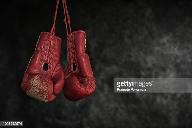 quit boxing,old boxing gloves the concept of retirement. - boxing ring stock pictures, royalty-free photos & images