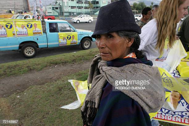 An Ecuadorean indigenous woman stands next to supporters of presidential candidate Alvaro Noboa in Quito 11 October 2006 Ecuadorean presidential...