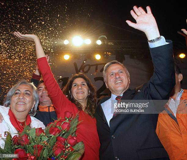 Ecuadorean presidential candidate moderate socialist Leon Roldos and his niece Martha Roldos wave to supporters during their campaign closing rally...