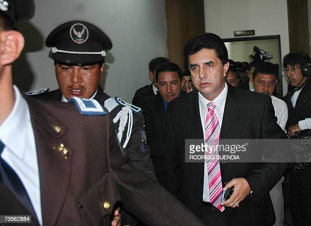 The President of Ecuador's National Congress Jorge Cevallos is escorted by policemen as he leaves the room after adjourning a session for lack of...