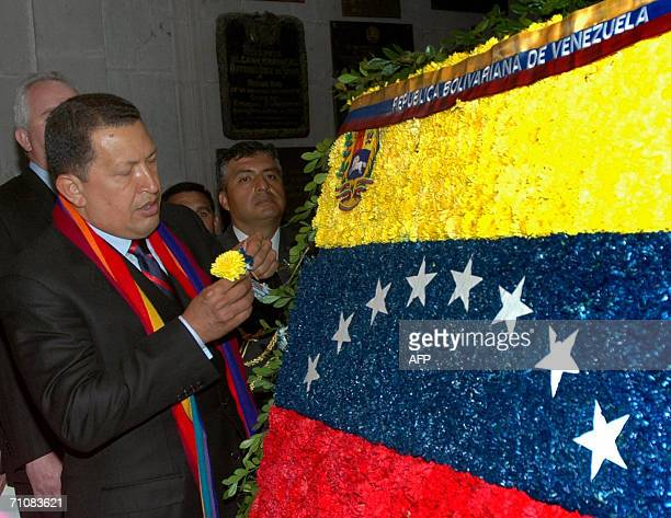 The Venezuelan President Hugo Chavez lays a wreath on XIXth Century hero Mariscal Antonio Jose de Sucre 30 May 2006 in Quito Chavez who is in a brief...
