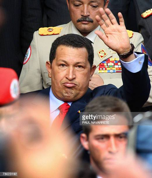 Venezuelan President Hugo Chavez waves to followers while leaving the grave of Marshal Antonio Jose de Sucre in the Metropolitan Cathedral in Quito...