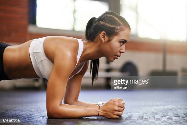 quitting is never an option - plank exercise stock pictures, royalty-free photos & images