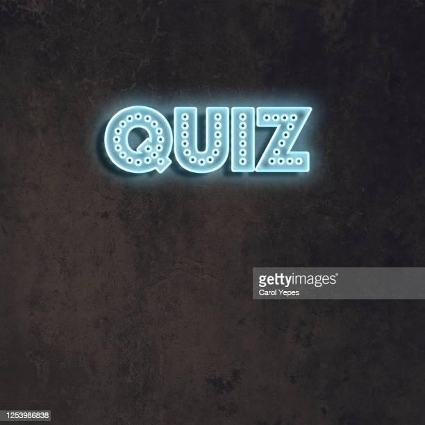 quiz word in blue neon lights.black background - test match bildbanksfoton och bilder