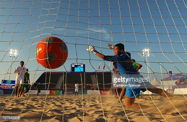 Quoc Hoang Trang of Vietnam dives in vain as the ball hits the back of the net in the Beach Soccer match between Vietnam and Palestine at AlMusannah...