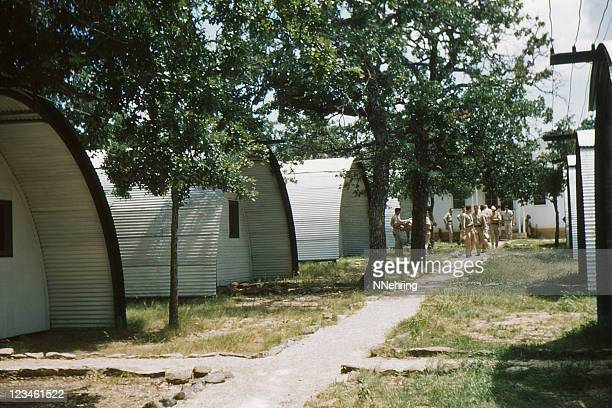 wwii quonset huts on military base 1949, retro - barracks stock pictures, royalty-free photos & images