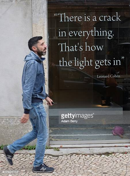 A quotation from the song 'Anthem' by Canadian songwriter and singer Leonard Cohen is seen on a shop window on November 11 2016 in Lisbon Portugal...