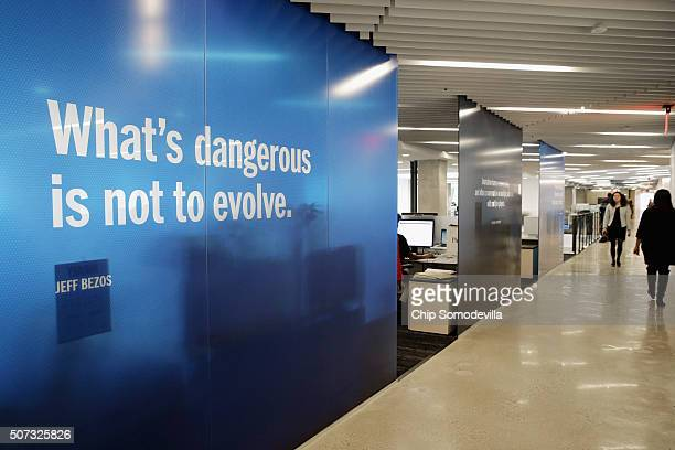 Quotes from Washington Post owner Jeff Bezos are written on glass walls in the newspaper's news room in its new headquarters January 28 2016 in...