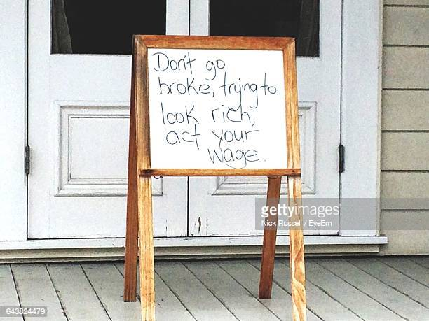 Quotes Written On Blackboard Outside House