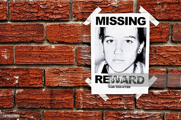"""""""missing"""" poster of teenage girl taped to red brick wall - kidnapping stock pictures, royalty-free photos & images"""