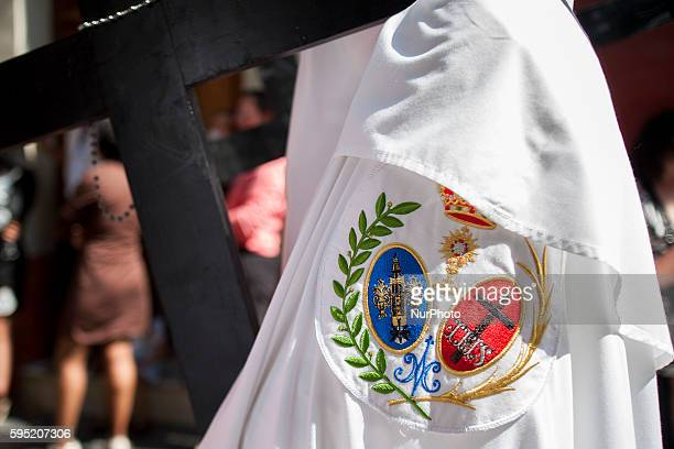 A quotnazarenoquot of the Brotherhood called quotLa Pazquot during its parade to Cathedral on Sunday of Palms day called Domingo de Ramos in Spanish...