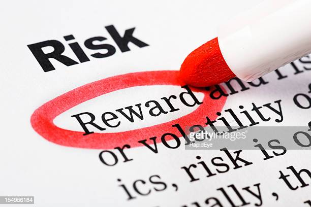 """""""Reward"""" highlighted in red under heading """"Risk"""" on printed document"""