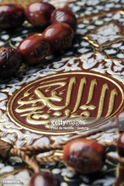 Quran and Tasbih (prayer beads).  France.