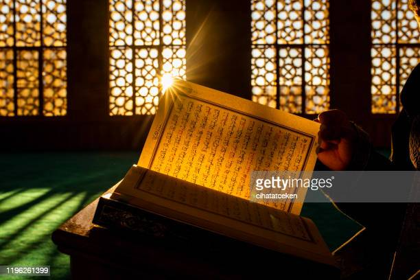 quran in the mosque - mosque stock pictures, royalty-free photos & images