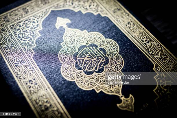 quran on wooden background - koran stock pictures, royalty-free photos & images
