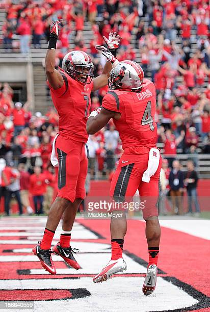 Quron Pratt of the Rutgers Scarlet Knights celebrates with Leonte Carroo after Carroo scored the game winning touchdown against the Temple Owls at...
