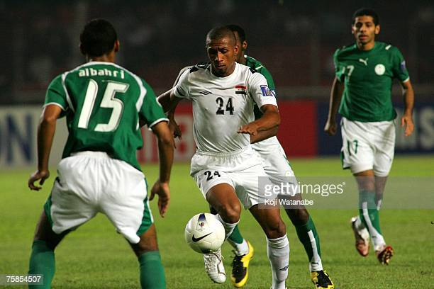 Qusay Munir of Iraq and Ahmed Al Bahari of Saudi Arabia during the AFC Asian Cup 2007 final between Iraq and Saudi Arabia at Gelora Bung Karno...