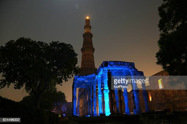 Qutub Minar monument is illuminated in blue on the 70th anniversary of the United Nations in New Delhi on 24 October 2015