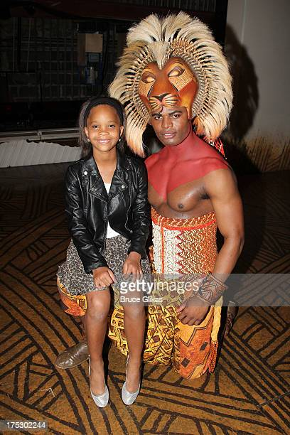 Quvenzhané Wallis and Andile Gumbi as Simba pose backstage at the hit musical The Lion King on Broadway at The Minskoff Theater on August 1 2013 in...