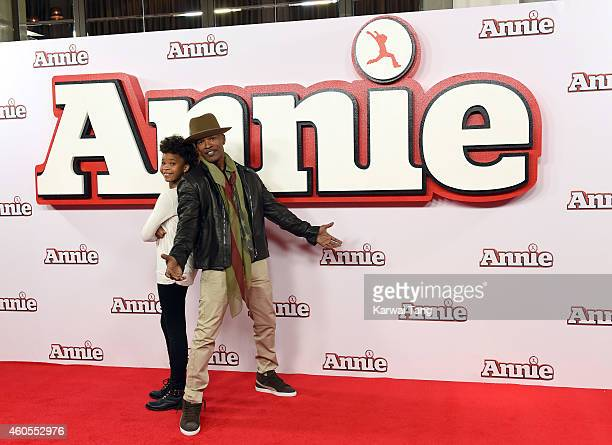 """Quvenzhane Wallis and Jamie Foxx attend a photocall for """"Annie"""" at Corinthia Hotel London on December 16, 2014 in London, England."""