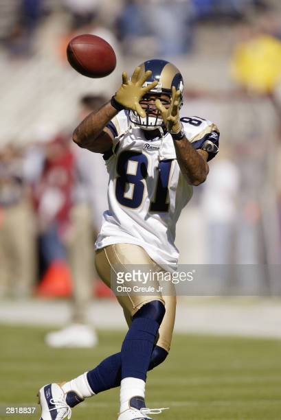 QWide receiver Torry Holt of the St Louis Rams gets ready to catch a pass during the game against the Arizona Cardinals on November 23 2003 at Sun...