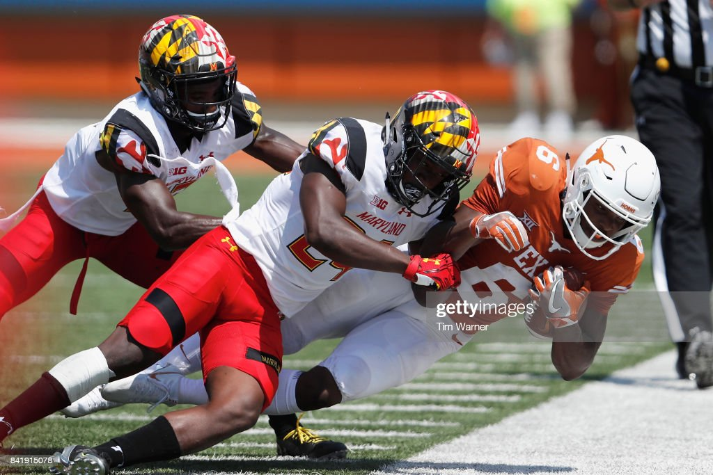 Qwuantrezz Knight #24 of the Maryland Terrapins tackles Devin Duvernay #6 of the Texas Longhorns in the second qurter at Darrell K Royal-Texas Memorial Stadium on September 2, 2017 in Austin, Texas.