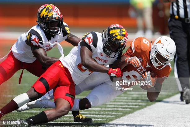 Qwuantrezz Knight of the Maryland Terrapins tackles Devin Duvernay of the Texas Longhorns in the second qurter at Darrell K RoyalTexas Memorial...