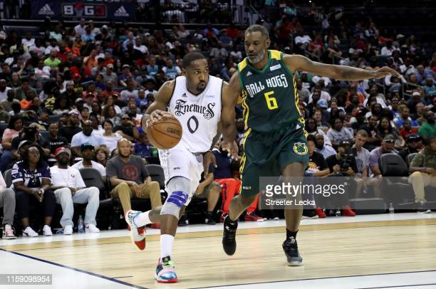 Qyntel Woods of Ball Hogs defends against Gilbert Arenas of Enemies of Enemies during week two of the BIG3 three on three basketball league at...