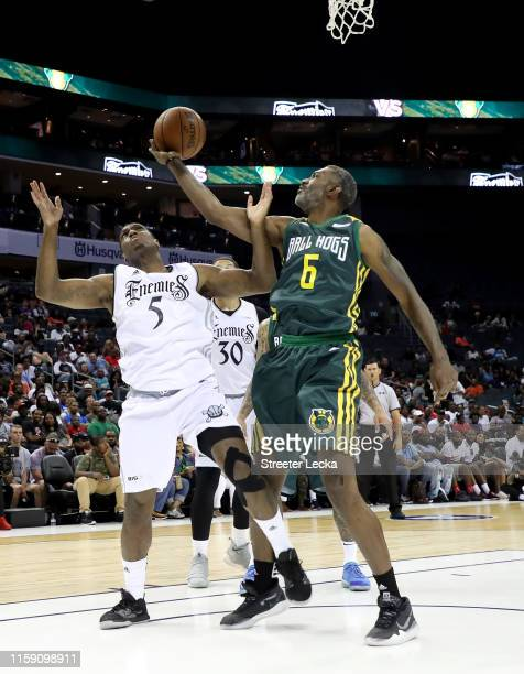 Qyntel Woods of Ball Hogs rebounds against Frank Robinson of Enemies during week two of the BIG3 three on three basketball league at Spectrum Center...