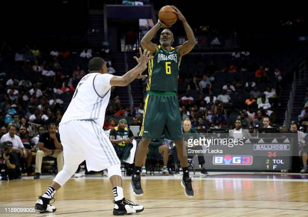 Qyntel Woods of Ball Hogs shoots over Craig Smith of Enemies during week two of the BIG3 three on three basketball league at Spectrum Center on June...
