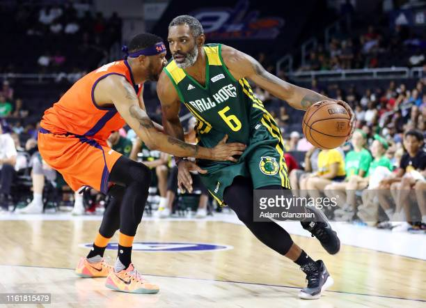 Qyntel Woods of the Ball Hogs dribbles against 3's Company during week four of the BIG3 three on three basketball league at Dunkin' Donuts Center on...