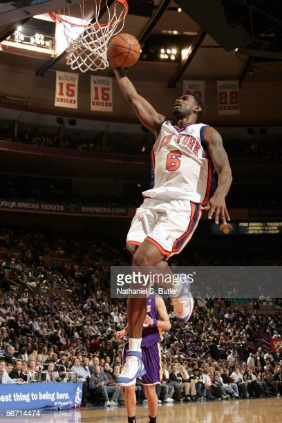 Qyntel Woods of the New York Knicks dunks against the Los Angeles Lakers on January 31 2006 at Madison Square Garden in New York City The Lakers...