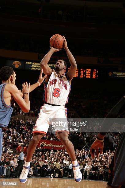 Qyntel Woods of the New York Knicks shoots against Jared Jeffries of the Washington Wizards on January 6 2006 at Madison Square Garden in New York...