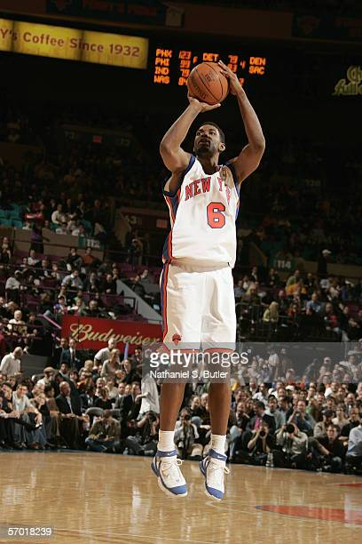 Qyntel Woods of the New York Knicks shoots against the Los Angeles Lakers at Madison Square Garden on January 31 2006 in New York New York The Lakers...