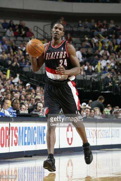 Qyntel Woods of the Portland Trail Blazers moves the ball during the game against the Dallas Mavericks at American Airlines Arena on February 28 2004...