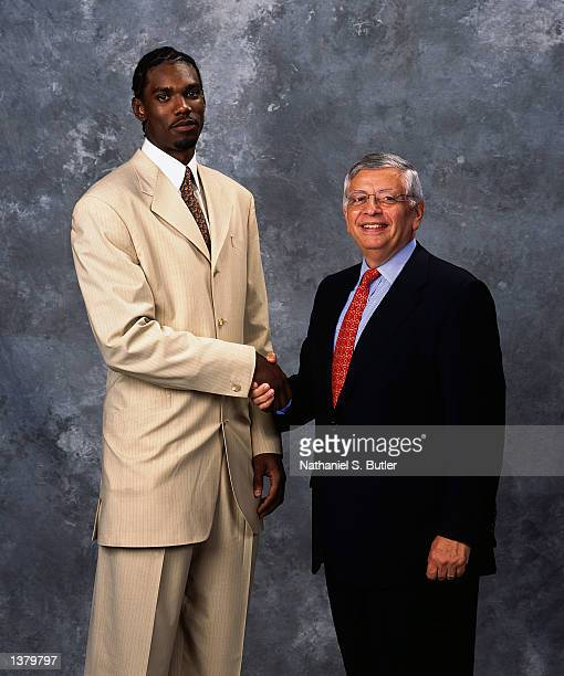 Qyntel Woods of the Portland Trailblazers and NBA Commissioner David Stern pose for a portrait during the 2002 NBA Draft at The Theater At Madison...