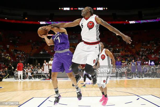 Qyntel Woods of Trilogy blocks a shot by Alex Scales of the Ghost Ballers during week eight of the BIG3 three on three basketball league at...