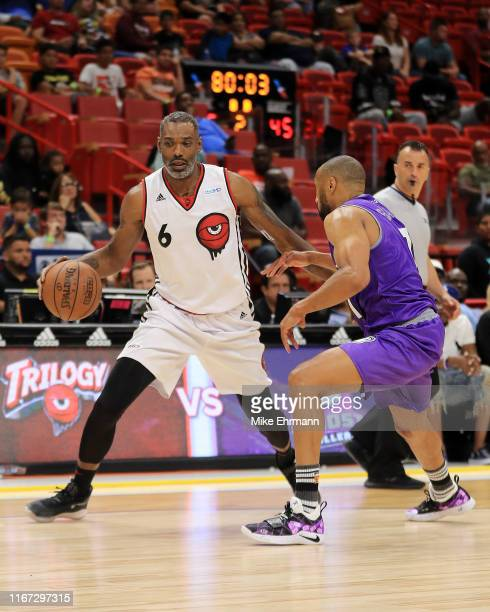 Qyntel Woods of Trilogy is defended by Alex Scales of the Ghost Ballers during week eight of the BIG3 three on three basketball league at...