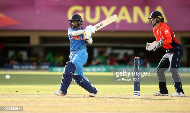 r Mithali Raj of India bats with Amy Jones wicket keeper of England looking on during the warm up match between England and India ahead of the ICC...