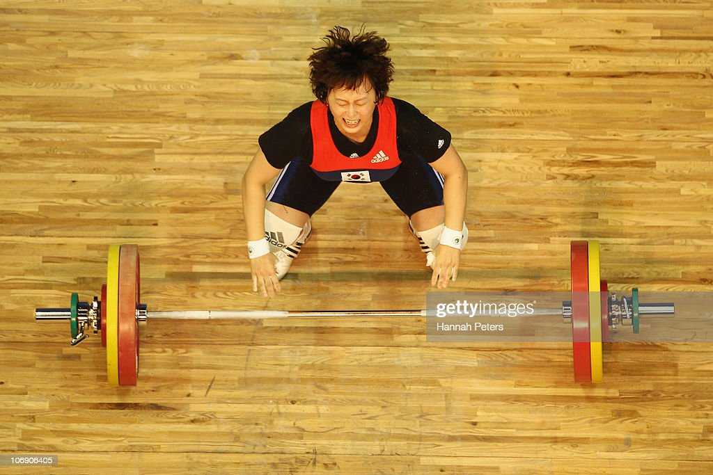 Ra Yu Mun of Korea drops the bar in the Women's Weightlifting 63kg competition during day four of the 16th Asian Games Guangzhou 2010 at Dongguan Gymnasium on November 16, 2010 in Guangzhou, China.