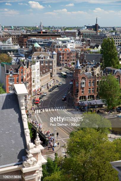 raadhuisstraat, amsterdam, as seen from the westerkerk - as stock pictures, royalty-free photos & images